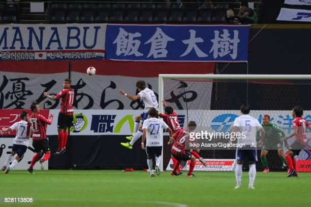 Takahiro Ogihara of Yokohama FMarinos heads the ball to score his side's first gola during the JLeague J1 match between Consadole Sapporo and...