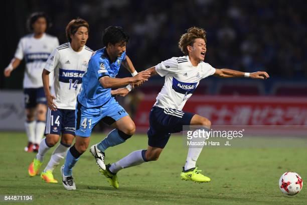 Takahiro Ogihara of Yokohama FMarinos is challenged by Akihiro Ienaga of Kawasaki Frontale during the JLeague J1 match between Kawasaki Frontale and...