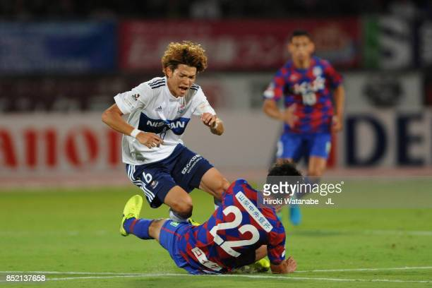 Takahiro Ogihara of Yokohama FMarinos is tackled by Yuta Koide of Ventforet Kofu during the JLeague J1 match between Ventforet Kofu and Yokohama...