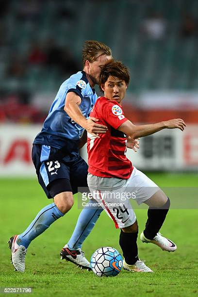 Takahiro Sekine of the Red Diamonds and Rhyan Grant of Sydney FC contest the ball during the AFC Asian Champions League match between Sydney FC and...
