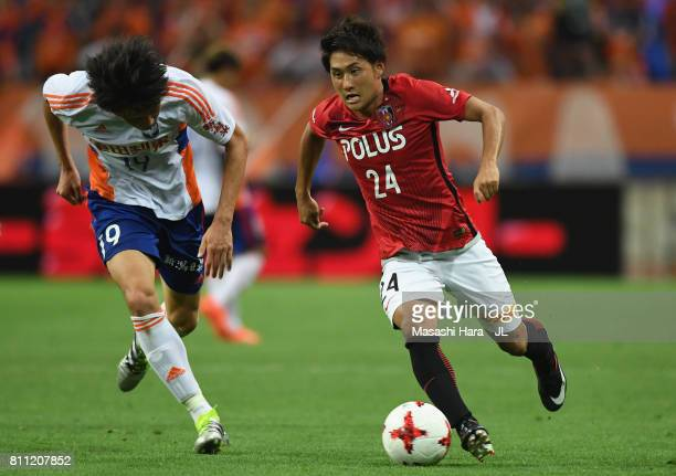 Takahiro Sekine of Urawa Red Diamonds and Kisho Yano of Albirex Niigata compete for the ball during the JLeague J1 match between Urawa Red Diamonds...