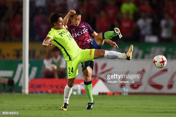 Takahiro Sekine of Urawa Red Diamonds and Shohei Abe of Ventforet Kofu compete for the ball during the JLeague J1 match between Ventforet Kofu and...