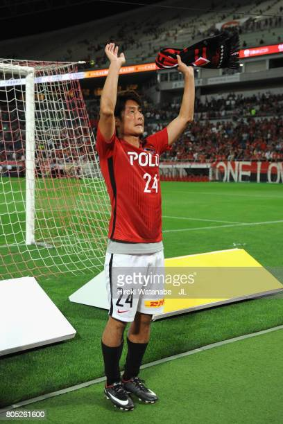 Takahiro Sekine of Urawa Red Diamonds applauds supporters after his side's 43 victory in the JLeague J1 match between Urawa Red Diamonds and...