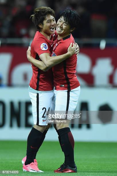 Takahiro Sekine of Urawa Red Diamonds celebrates scoring a goal with Yuki Muto of Urawa Red Diamonds during the AFC Champions League Group F match...