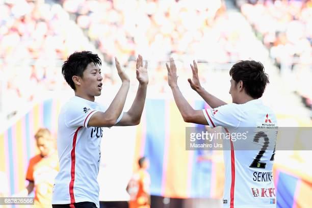 Takahiro Sekine of Urawa Red Diamonds celebrates scoring his side's fifth goal with his team mate Yuki Muto during the JLeague J1 match between...