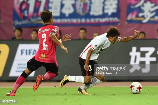 Takahiro Sekine of Urawa Red Diamonds goes past Riku Matsuda of Cerezo Osaka during the JLeague J1 match between Cerezo Osaka and Urawa Red Diamonds...
