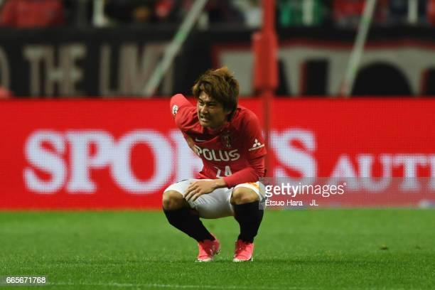 Takahiro Sekine of Urawa Red Diamonds holds his back during the JLeague J1 match between Urawa Red Diamonds and Vegalta Sendai at Saitama Stadium on...
