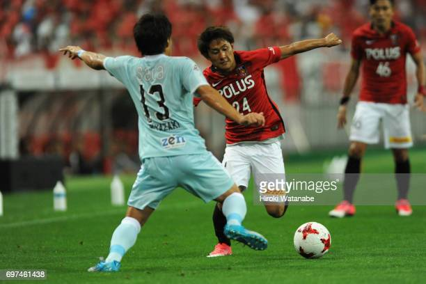 Takahiro Sekine of Urawa Red Diamonds in action during the JLeague J1 match between Urawa Red Diamonds and Jubilo Iwata at Saitama Stadium on June 18...