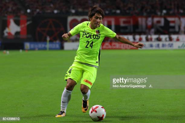 Takahiro Sekine of Urawa Red Diamonds in action during the JLeague J1 match between Consadole Sapporo and Urawa Red Diamonds at Sapporo Dome on July...