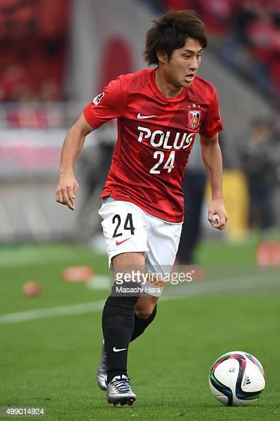 Takahiro Sekine of Urawa Red Diamonds in action during the JLeague 2015 Championship semi final match between Urawa Red Diamonds and Gamba Osaka at...