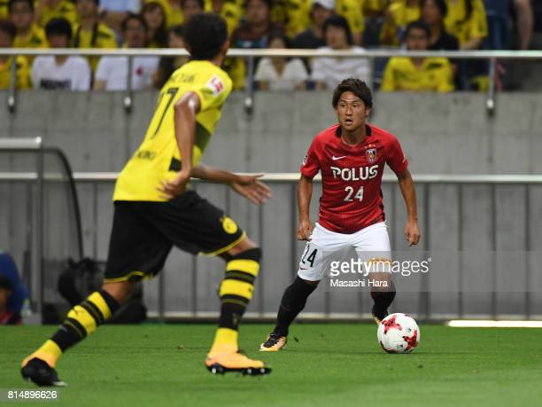 Takahiro Sekine of Urawa Red Diamonds in action during the preseason friendly match between Urawa Red Diamonds and Borussia Dortmund at Saitama...