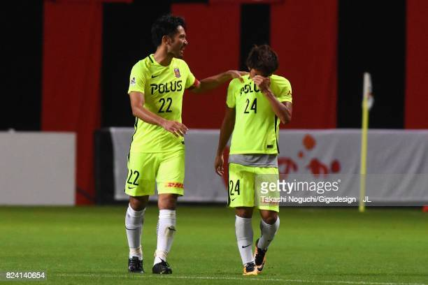 Takahiro Sekine of Urawa Red Diamonds is consoled by Yuki Abe during the JLeague J1 match between Consadole Sapporo and Urawa Red Diamonds at Sapporo...