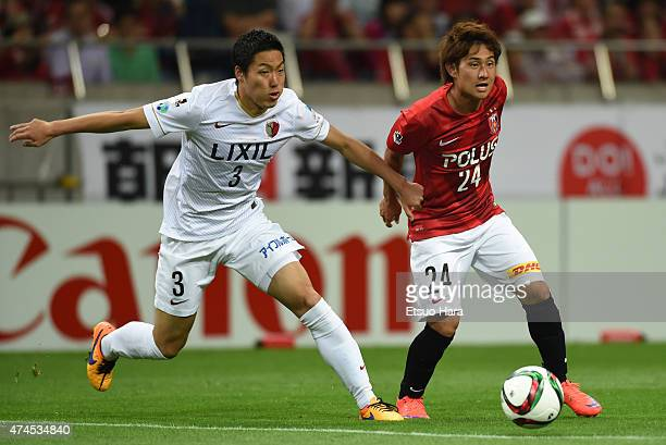Takahiro Sekine of Urawa Reds and Gen Shoji of Kashima Antlers compete for the ball during the JLeague match between Urawa Red Diamonds and Kashima...