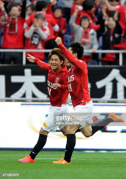 Takahiro Sekine of Urawa Reds celebrates scoring his team's first goal with his team mate Yuki Muto during the JLeague match between Urawa Red...
