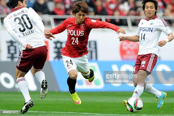 Takahiro Sekine of Urawa Reds in action during the JLeague match between Urawa Red Diamonds and Matsumoto Yamaga at Saitama Stadium on April 4 2015...