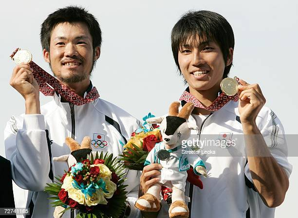 Takahiro Suda and Team Japan hold their Gold Medal in the Men's Lightweight Double Sculls Rowing Competition during the 15th Asian Games Doha 2006 at...