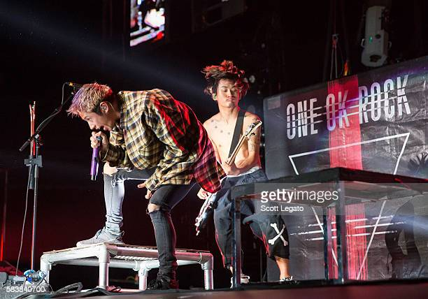 Takahiro 'Taka' Moriuchi and Ryota Kohama of One OK Rock performs at The Palace of Auburn Hills on July 27 2016 in Auburn Hills Michigan