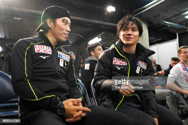Takahito Mura and Shoma Uno of Japan talk after competing in the Men's Singles Short Program during day one of the ISU Grand Prix of Figure Skating...