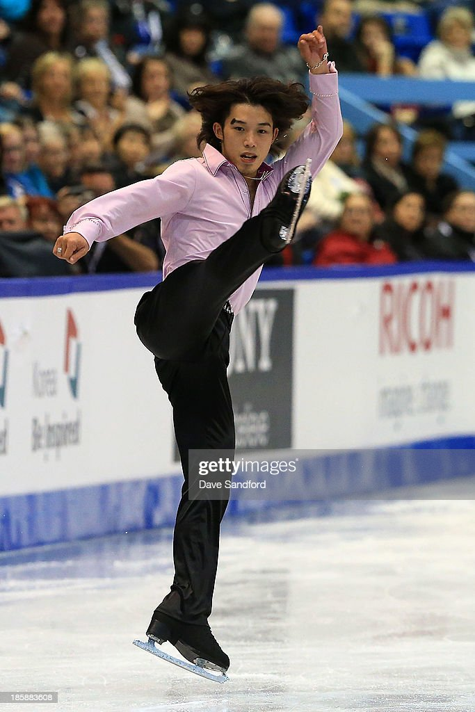 <a gi-track='captionPersonalityLinkClicked' href=/galleries/search?phrase=Takahito+Mura&family=editorial&specificpeople=5621586 ng-click='$event.stopPropagation()'>Takahito Mura</a> of Japan skates during the men's short program at the ISU GP 2013 Skate Canada International at Harbour Station on October 25, 2013 in Saint John, New Brunswick, Canada.