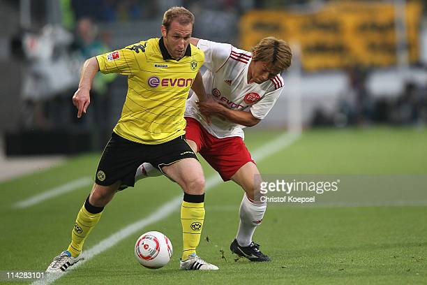 Takahito Soma of Japan challenges Florian Kringe of Dortmund during the charity match between Borussia Dortmund and a Team of Japan at the...