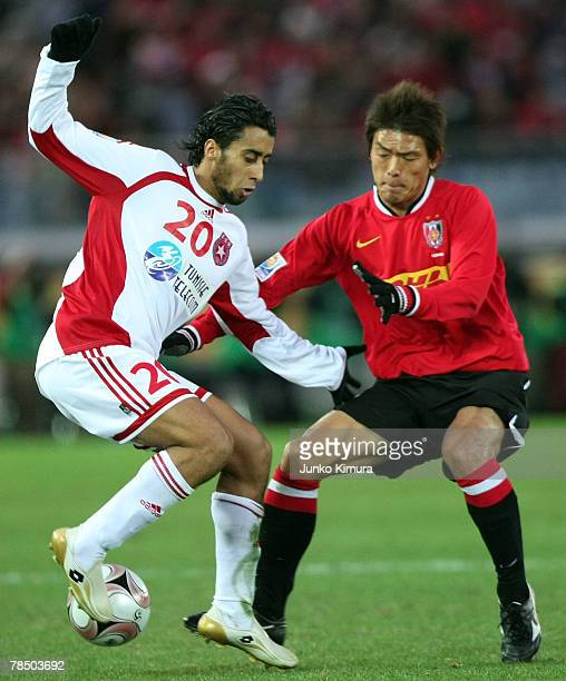 Takahito Soma of Urawa Red Diamonds and Khaled Melliti of Etoile Sportive du Sahel compete for the ball during the FIFA Club World Cup match for...