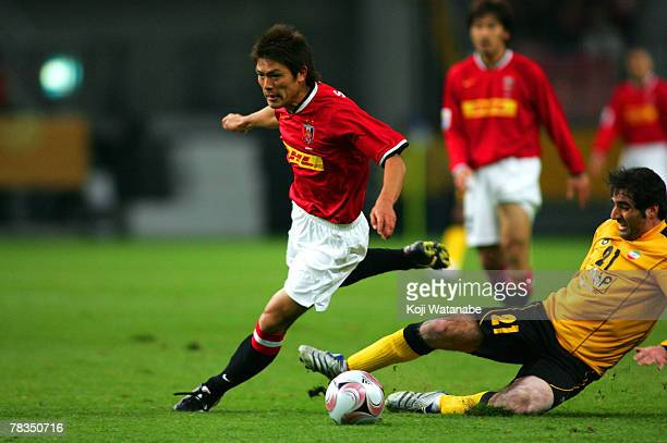 Takahito Soma of Urawa Red Diamonds and Saeid Bayat of Sepahan compete for the ball during the FIFA Club World Cup match between Urawa Red Diamonds...