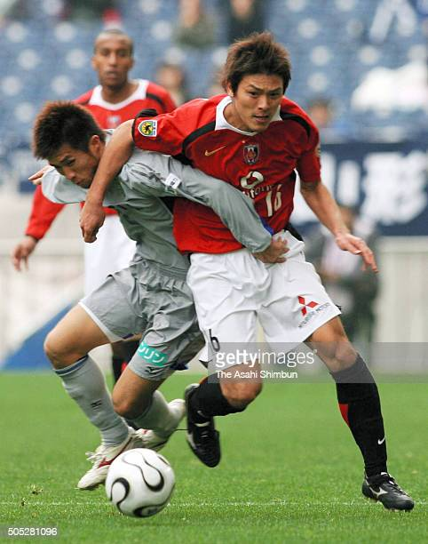 Takahito Soma of Urawa Red Diamonds and Toru Miyamoto of Avispa Fukuoka compete for the ball during the 86th Emperor's Cup fifth round match between...