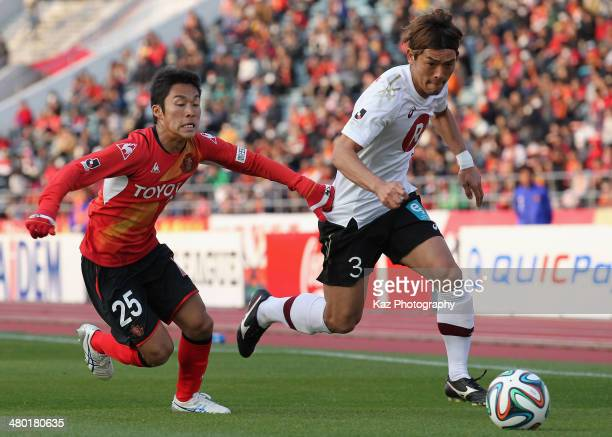 Takahito Soma of Vissel Kobe and Reo Mochizuki of Nagoya Grampus compete for the ball during the J League match between Nagoya Grampus and Vissel...