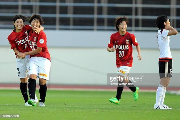 Kiko Seike of Urawa Reds Ladies celebrates scoring her team's first goal with her team mate Hikaru Naomoto during the Nadeshiko League match between...