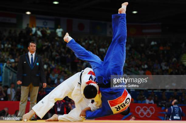 Takamasa Anai of Japan and James Austin of Great Britain compete in the Men's 100 kg Judo on Day 6 of the London 2012 Olympic Games at ExCeL on...
