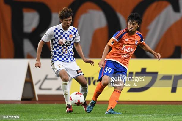 Takamitsu Tomiyama of Albirex Niigata and Yasuhiro Hiraoka of Vegalta Sendai compete for the ball during the JLeague J1 match between Albirex Niigata...