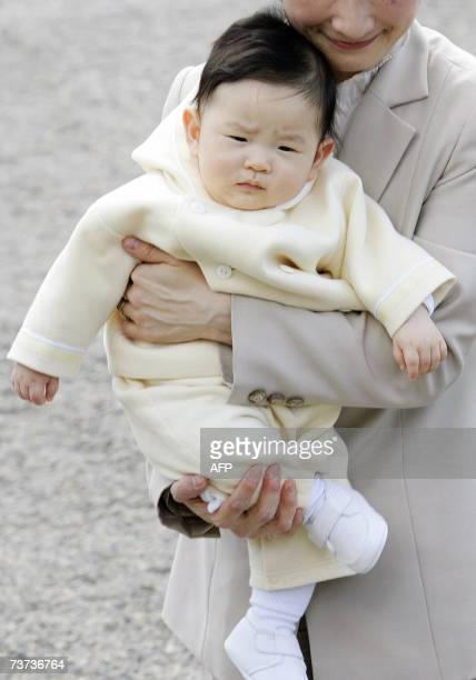 Prince Hisahito carried by his mother Princess Kiko arrives at the imperial farm in Takanezawa North of Tokyo 29 March 2007 Prince Akishino Kiko and...
