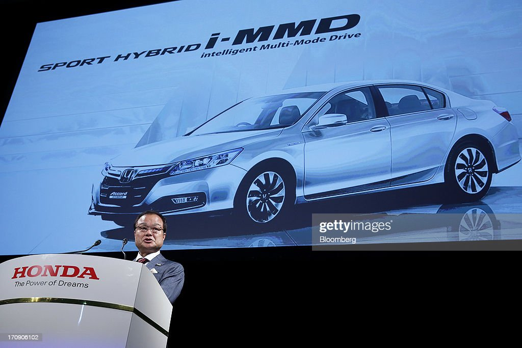 Takanobu Ito, president and chief executive officer of Honda Motor Co., speaks during the unveiling of the company's Accord hybrid sedan and Accord plug-in hybrid sedan in Tokyo, Japan, on Thursday, June 20, 2013. Honda, Japan's third-largest carmaker, unveiled a hybrid sedan at a 20 percent higher price than Toyota Motor Corp.'s gasoline-electric Camry, betting drivers will pay extra for fuel economy. Photographer: Kiyoshi Ota/Bloomberg via Getty Images