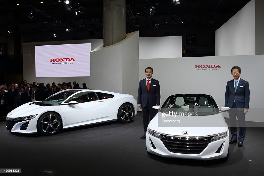 Takanobu Ito, president and chief executive officer of Honda Motor Co., left, and Sho Minekawa, chief operating officer for regional sales operations in Japan, pose with the company's NSX Concept, left, and Honda S660 Concept vehicles during a news conference at the 43rd Tokyo Motor Show 2013 in Tokyo, Japan, on Wednesday, Nov. 20, 2013. The autoshow will be open to the public from Nov. 23 to Dec. 1 at the Tokyo International Exhibition Center, also known as the Tokyo Big Sight. Photographer: Tomohiro Ohsumi/Bloomberg via Getty Images