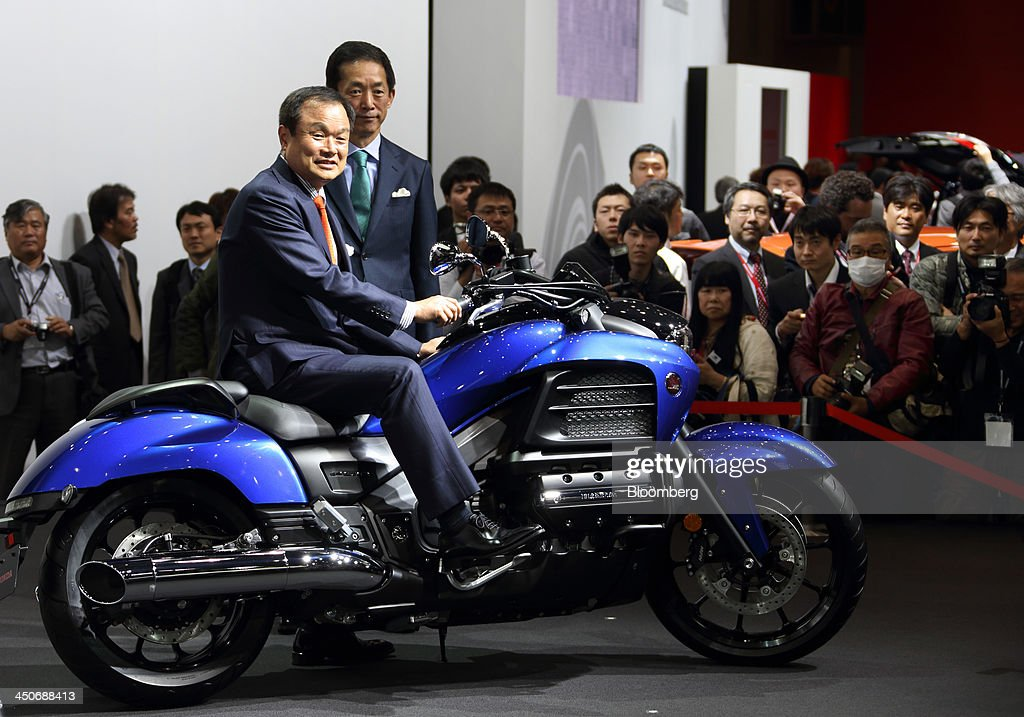 Takanobu Ito, president and chief executive officer of Honda Motor Co., left, and Sho Minekawa, chief operating officer for regional sales operations in Japan, pose with the company's Gold Wing F6C motorcycle during a news conference at the 43rd Tokyo Motor Show 2013 in Tokyo, Japan, on Wednesday, Nov. 20, 2013. The autoshow will be open to the public from Nov. 23 to Dec. 1 at the Tokyo International Exhibition Center, also known as the Tokyo Big Sight. Photographer: Tomohiro Ohsumi/Bloomberg via Getty Images