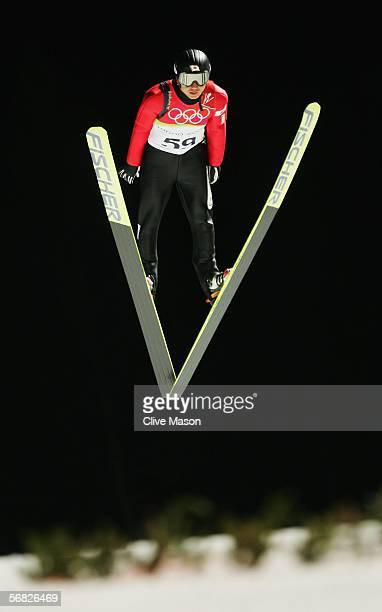 Takanobu Okabe of Japan competes in the Normal Hill Individual Ski Jumping Qualifying on Day 1 of the 2006 Turin Winter Olympic Games on February 11...