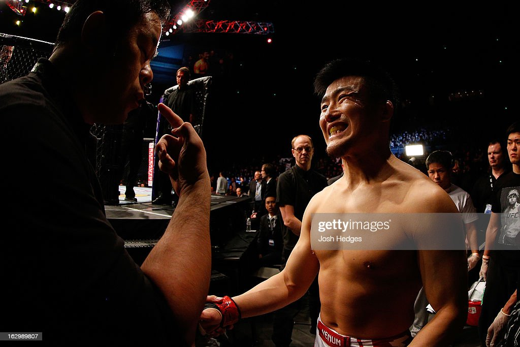 Takanori Gomi prepares to enter the Octagon before his lightweight fight against Diego Sanchez during the UFC on FUEL TV event at Saitama Super Arena on March 3, 2013 in Saitama, Japan.
