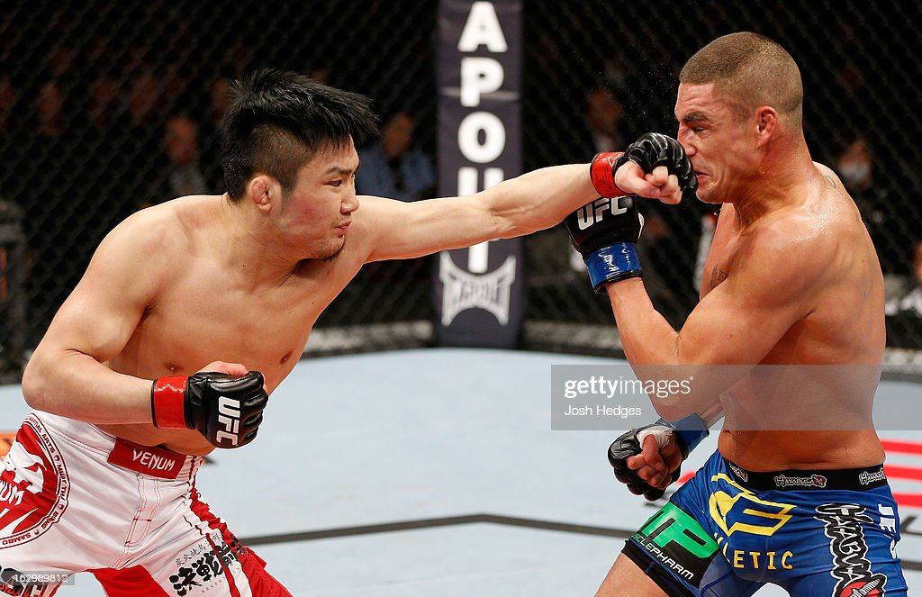 Takanori Gomi punches Diego Sanchez in their lightweight fight during the UFC on FUEL TV event at Saitama Super Arena on March 3, 2013 in Saitama, Japan.