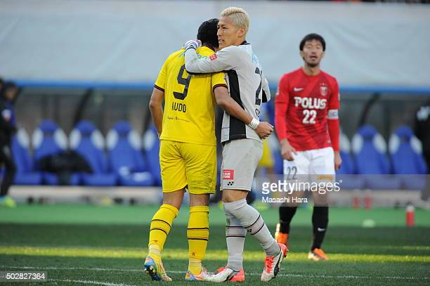 Takanori Sugeno of Kashiwa Reysol hugs Masato Kudo after the 95th Emperor's Cup semi final match between Urawa Red Diamonds and Kashiwa Reysol at...