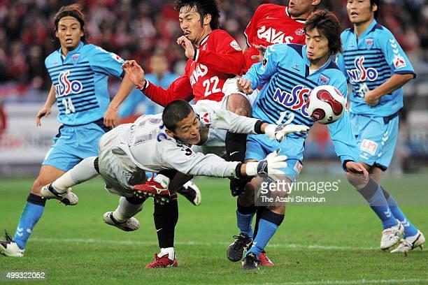 Takanori Sugeno of Yokohama FC and Yuki Abe of Urawa Red Diamonds compete for the ball during the JLeague match between Yokohama FC and Urawa Red...