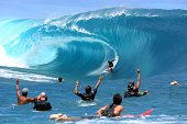 Takanui Smith rides a wave as fellow surfers and filming crew react during the shooting of a remake of the 1991 classic 'Point Break' on September 11...