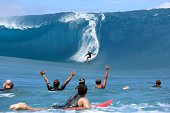 Takanui Smith rides a wave as fellow surfers and filming crew reacts during the shooting of a remake of the 1991 classic 'Point Break' on September...