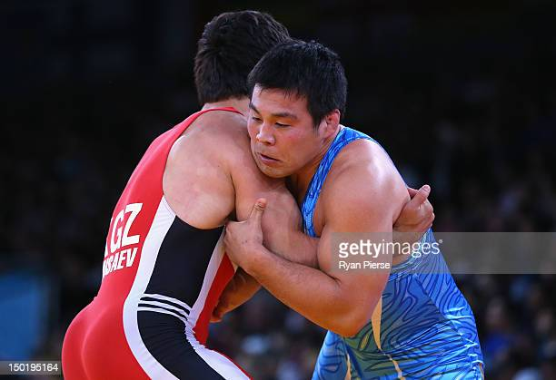 Takao Isokawa of Japan in action against Magomed Musaev of Kyrgyzstan in the Men's Freestyle Wrestling 96kg 1/8 final match on Day 16 of the London...