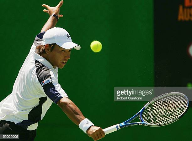 Takao Suzuki of Japan hits against JanMichael Gambill of the USA during day one of the Australian Open Grand Slam at Melbourne Park January 17 2005...