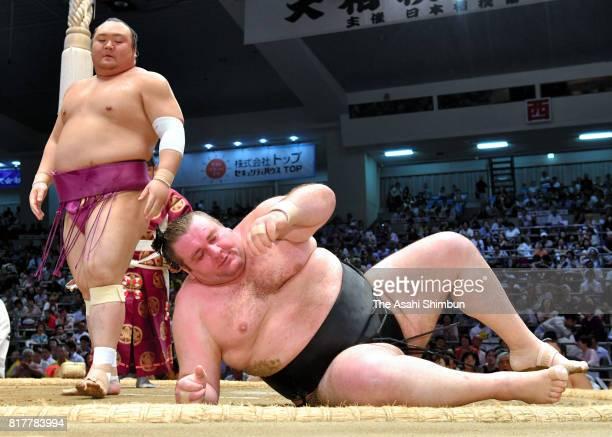 Takarafuji throws Georgian wrestler Gagamaru to win during day ten of the Grand Sumo Nagoya Torunament at Aichi Prefecture Gymnasium on July 18 2017...