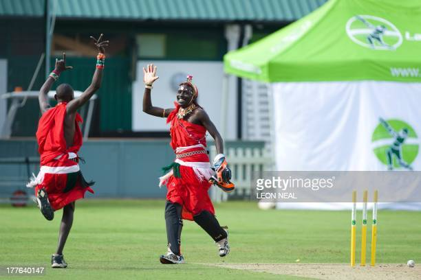 Takare Njayo Thomas Meshami of the Maasai Warrior cricket team is congratulated by Tepele Francis Siranga Naimodo after taking a wicket in a friendly...
