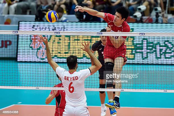Takashi Dekita of Japan spikes the ball in the match against Iran during the FIVB Men's Volleyball World Cup Japan 2015 at the Osaka Municipal...