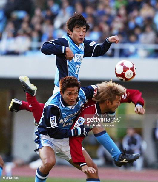 Takashi Fukunishi of Jubilo Iwata and Takayuki Suzuki of Kashima Antlers compet for the ball during the JLeague Championship first leg match between...