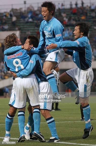Takashi Fukunishi of Jubilo Iwata celebrates scoring his team's first goal with his team mates during the JLeague match between Vissel Kobe and...