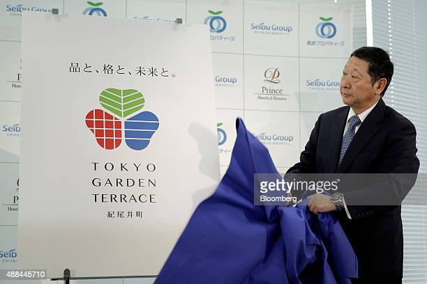 Takashi Goto president of Seibu Holdings Inc unveils the logo for the company's Tokyo Garden Terrace complex during a news conference in Tokyo Japan...